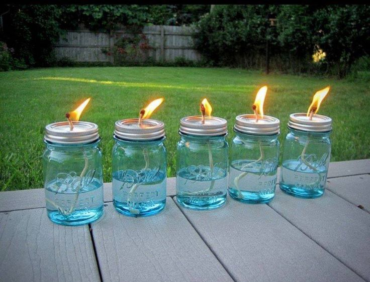 DIY bonfire lights to keep bugs away! Package of Mason jars, some cotton string and some liquid citronella (find it in big jugs at any home-improvement store and even some grocery stores). Use a hammer and nail to poke a hole in the top of the lid, then pour in the citronella, put the top on and drop in the wick. Allow the string about 10 minutes to soak up some oil.