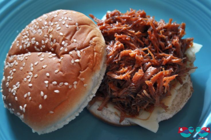 Quick and Easy Pulled BBQ Pork Sandwiches made in the crock pot @ The Love Nerds