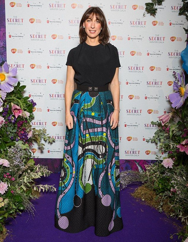 Samantha Cameron dazzled in a vibrant printed floor-length skirt as she stepped out for th...