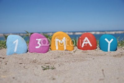 13 may mother's day on colourful stones with sand background