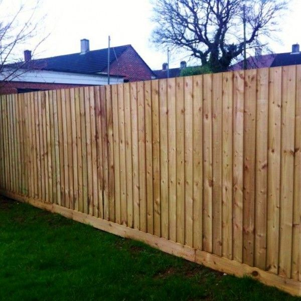 Front view New Feather Edge Garden Fencing customers house Airdrie Scotland, vertical feather edge planks on strong