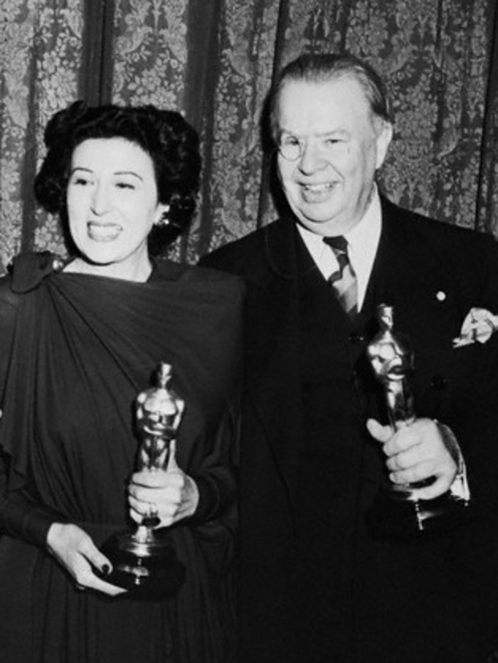 "Katina Paxinou with Oscar she won for the film ""For Whom the Bell Tolls"" along with actor Charles Coburn who won for ""The More the Merrier"" (circa 1944)"