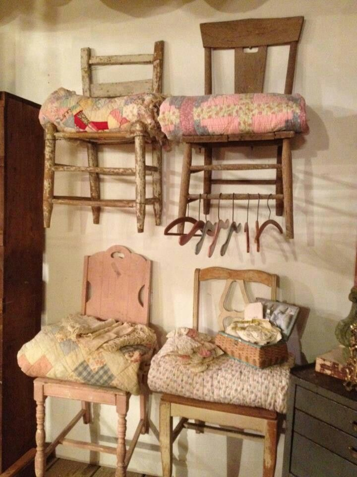 Old chairs on the wall as shelves for quilts.  Lovely                                                                                                                                                     More