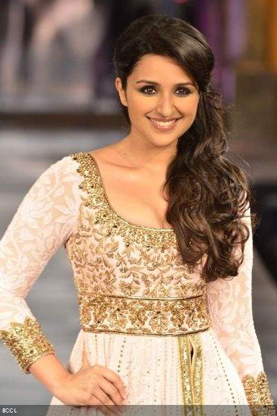 Parineeti Chopra showcases Manish Malhotra's creation during Shabana Azmi's charity fundraising fashion show 'Mijwan' at Grand Hyatt in Mumbai on September 3, 2012.