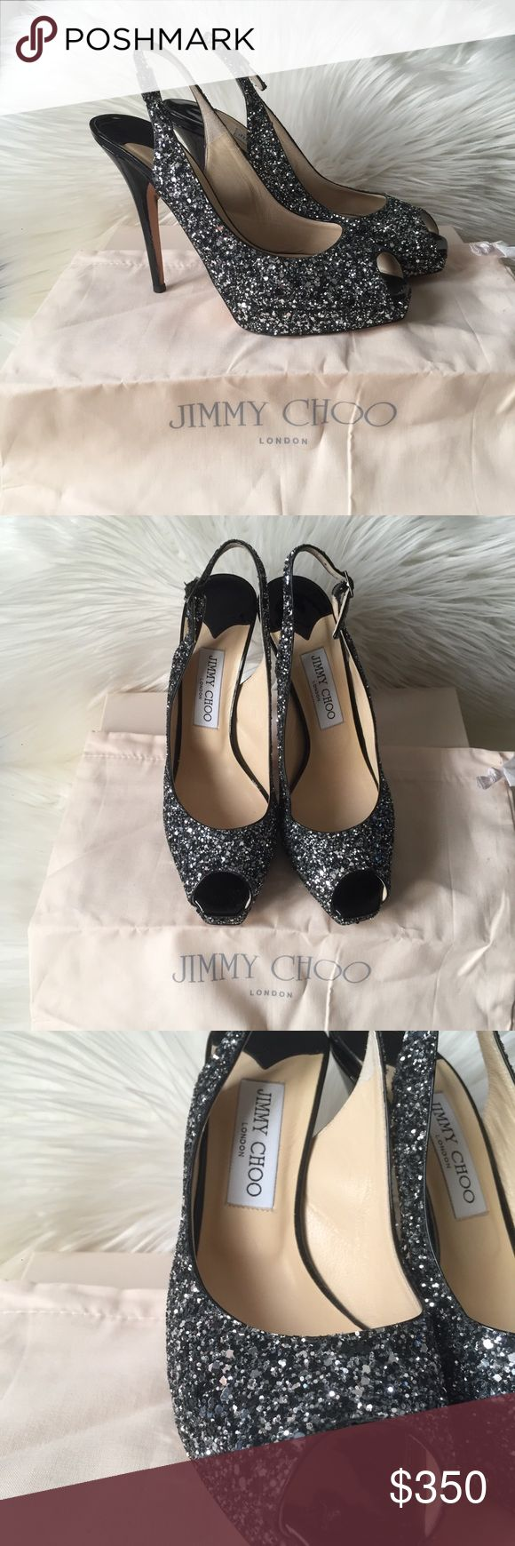 "Jimmy Choo Coarse Glitter Pero Toe Heels Black patent peep toe stiletto heels with glitter silver coat. In excellent preowned condition minimal wear on the sole and tiny scratch on the heel. Comes with dust bag and box. Heel measures 4.75"" & 1"" platform Jimmy Choo Shoes Heels"