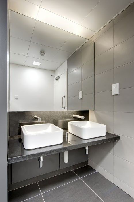 Simple Yet Modern Commercial Bathroom Sinks Plain White Sinks On A Black Counter With Silver