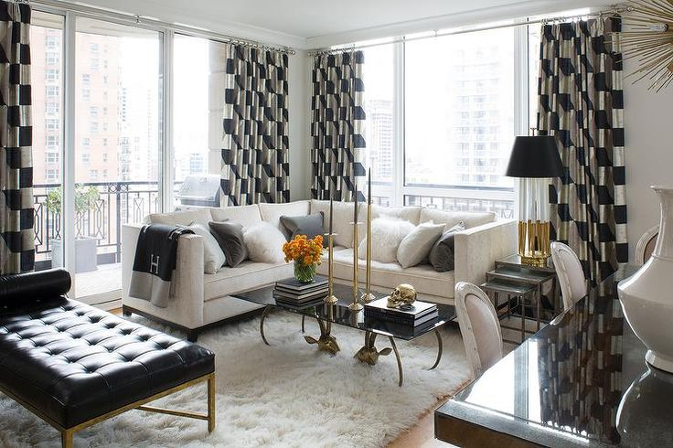 Ivory And Black Living Room Features An Ivory Sectional
