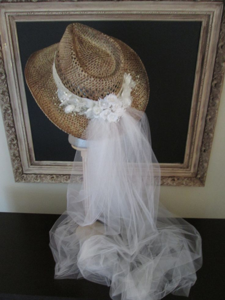 Wedding Veil Bridal Hat Beach Wedding  hat and veil-western wedding-cowgirl hat-Bridal cowgirl hat Wedding photo prop Bachelorette by Thecreativebride on Etsy https://www.etsy.com/listing/229777411/wedding-veil-bridal-hat-beach-wedding