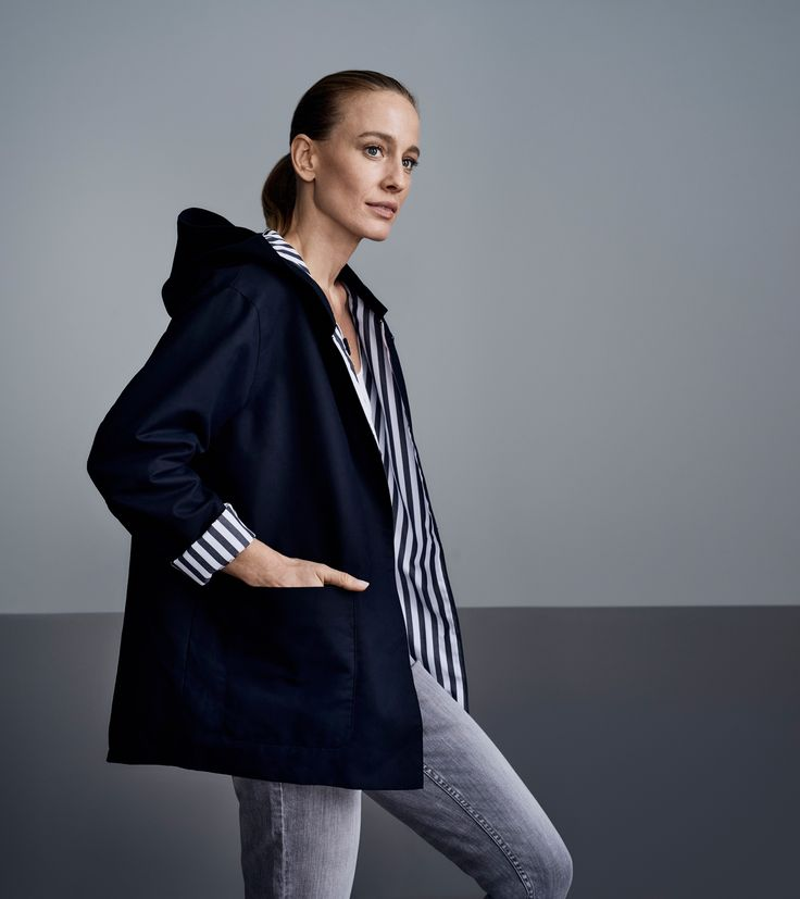The Modern Anorak.   A clean, pared back approach to the sporty anorak in smooth cotton double cloth, accented with bold striped lining.