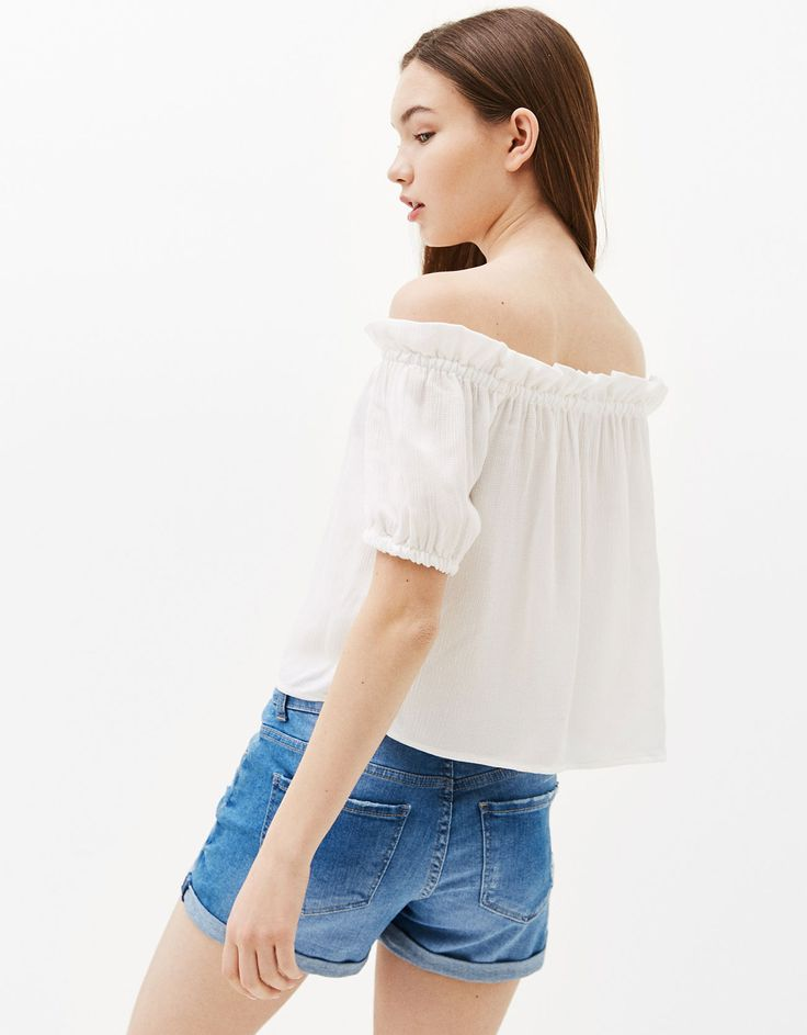 Off-the-shoulder flounced blouse. Discover this and many more items in Bershka with new products every week