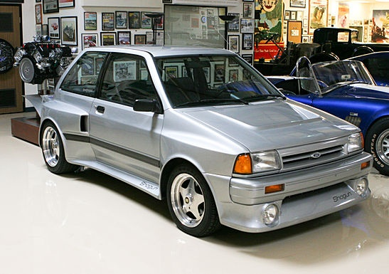 1989 Ford Shogun, a Ford Festiva with a Ford Taurus SHO drivetrain installed in the rear, this one looks like Jay Leno's.