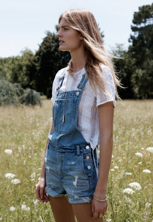Denim overall shorts and a huge field of daises.