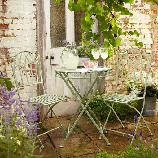 For a fabulous country look, try this neat painted metal set  Ornate Metal Folding Bistro set from, £35