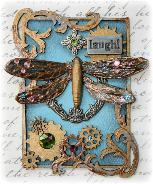 Steampunk style ATC made by Gabrielle Pollacco using Bo Bunny Double dot paper and Bo Bunny Dragonfly stamp (Serenade collection) along with Dusty Attic chipboard. (click photo for tips & tricks)