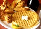 Dig into soul food at Gladys Knight's restaurant, famous for their Chicken and Waffles.