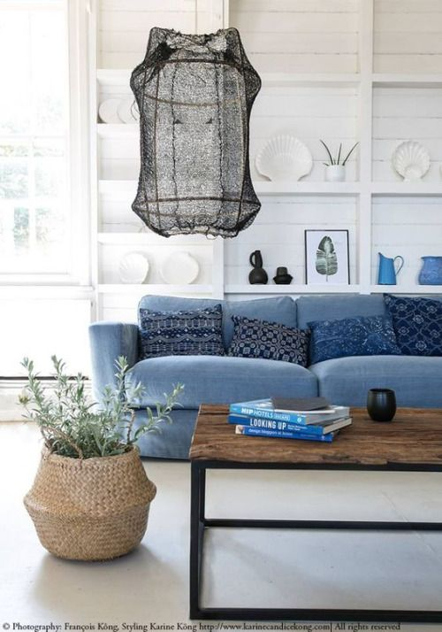 Blue sofa, wooden coffee table, white floors