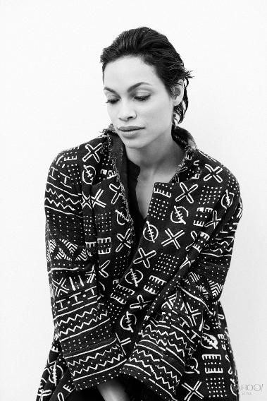 Rosario Dawson in a printed overcoat by Studio One Eighty Nine. Studio One Eighty Nine Black Pattern Jacket, Price Available Upon Request, openingceremony.us  Rosario's Own Black Dress