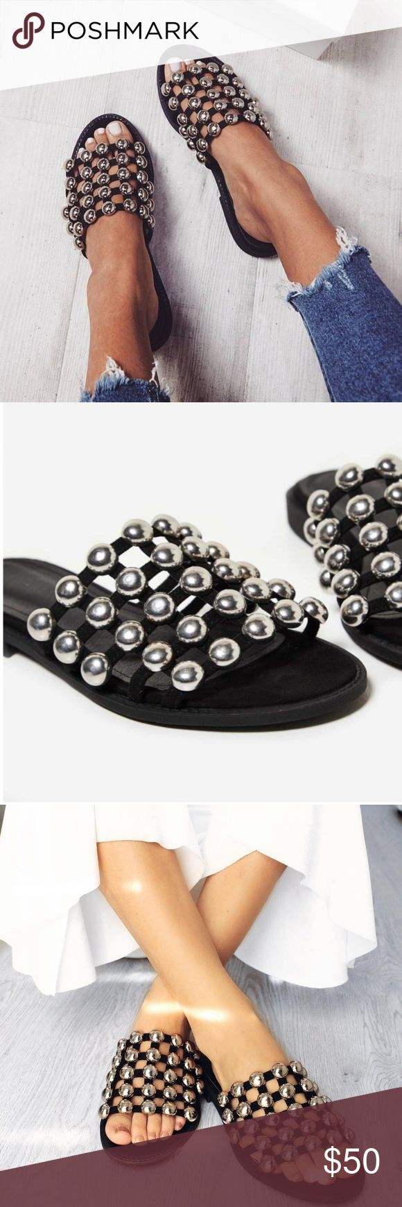 Black studded slides Seem on your favorite Bloggers! Studded Backless Sandal With Open Toe.   With Faux Suede Material And Single Front Strap, It's Perfect For Those Days On The Beach. Throw These On With Frayed Denim High-Waisted Shorts And Cropped Cami. Comes with box.  Black  Material: Synthetic Shoes Sandals