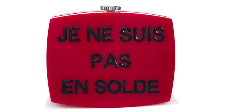 "Make a fashion statement - literally - with this Chanel clutch which reads, ""I am not for sale"""