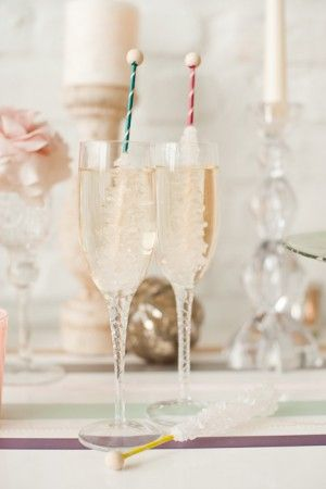Rock candy cocktail swizzle sticks in champagne for New Years Eve!