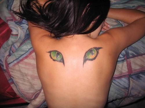 A tattoo of cats eyes on the back can be a symbol of the watchful, protective eyes of the Egyptian cat goddess Bast « « Ratta Tattoo
