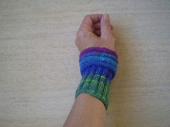 These cuffs fit snugly over the wrist and then open out into rippled bands. They are easy to knit, either in the round or flat and then seamed, and use only 30g of 4 ply yarn.