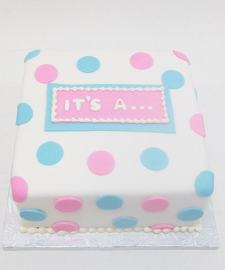 Gender Reveal Cake with pink and blue polka dots by Bake Sale Toronto.                                                                                                                                                      More