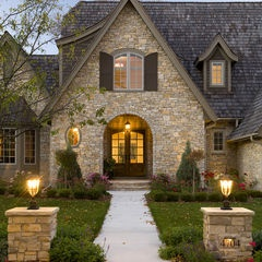 Lighted pillars flanking path to front door.  traditional exterior by Stonewood, LLC