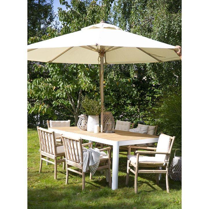 Nordlys havebord i formstøbt hvidt aluminium med bordplade i FSC® Teak. Caribien havestol i ubehandlet bambus inkl. hynde. Sætpris bord + 6 stole