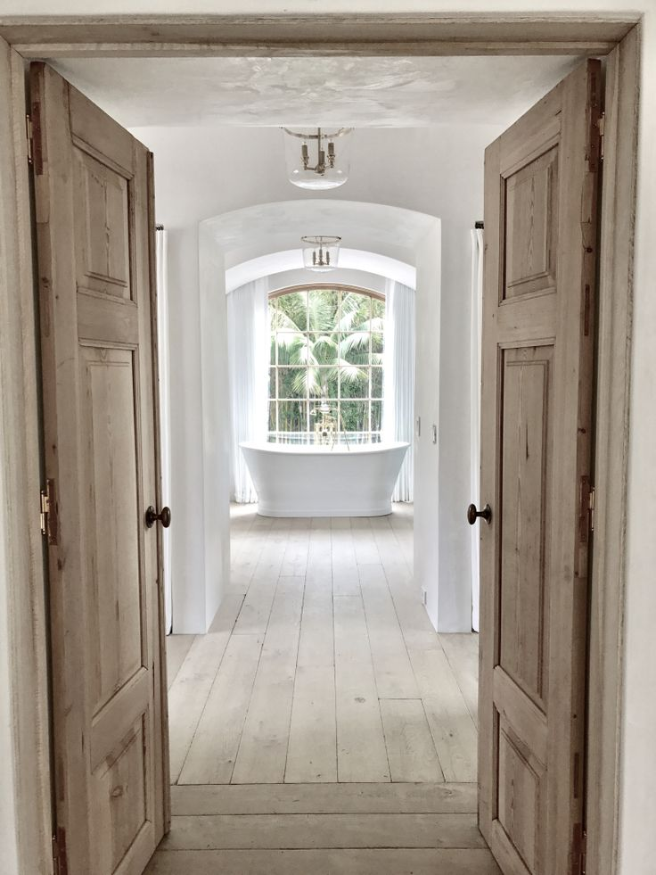 Giannetti Home Malibu project: Master Bath Tub, antique reproduction doors, wood floor