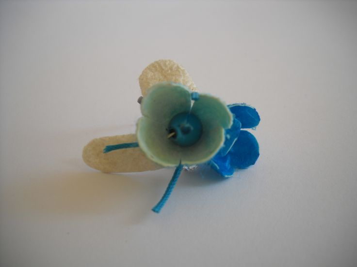 Handmade ring with wight and blue silk cocoons