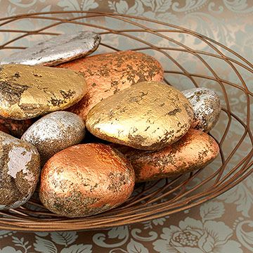 """add some shimmer to your Holiday (Thanksgiving or Christmas) table by coating ordinary rocks with gold, silver or copper leaf. leave some of the surface exposed to create a rustic look.""  What about pink & red foils for valentine day & green foils for St. Patricks."