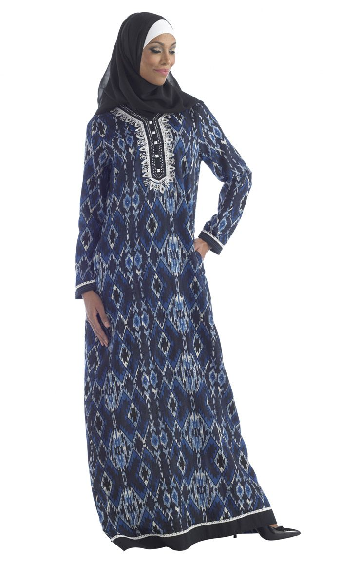 Aztec printed crepe Abaya with accent embroidery on the neck and semi mock button detail. Black fabric trim around sleeves and hem add to the intricacy of this design.
