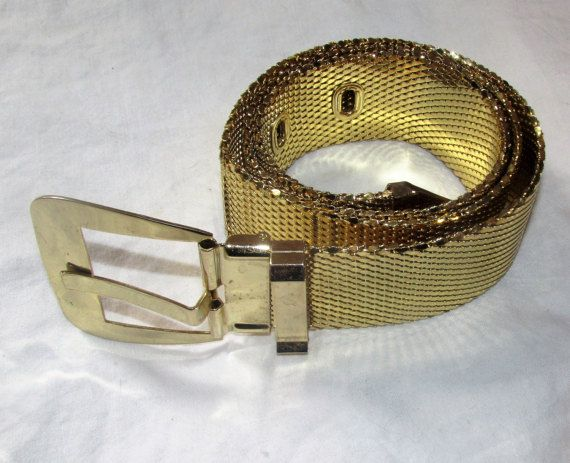 """Vintage Whiting and Davis Gold Mesh Belt Wide Metal Belt Vintage Metallic Belt Signed Womans Accessories    gold mesh belt from whiting and davis.  interlocking scale mesh.  solid buckle and tip.  3 holes to adjust size down.  signed on back of belt.  last picture shows a bend in the belt.  it is barely noticeable on the front but shows up on the reverse side.  1970s glam piece!  belt is 34"""" long x 1.5"""" wide.  buckle is 2.5"""".    from a smoke-free, child & pet loving home.    if you have a…"""