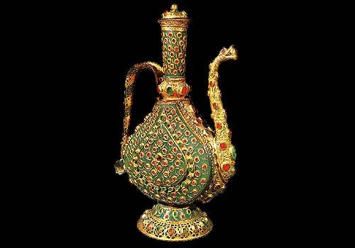 Voided with precious stones, silver ewer