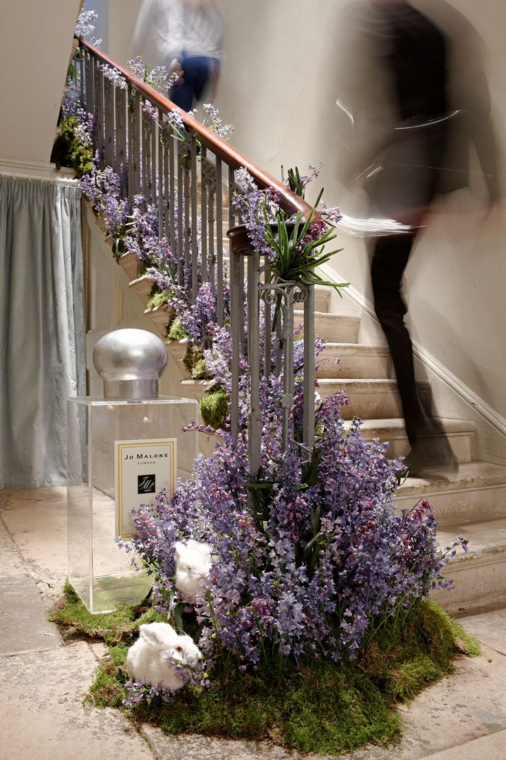 Decorate at the bottom of the railing, instead of the top, and the base of the stair post, for a different dramatic touch. (leaves rail free for hands ...)   http://lifestyleetc.co.uk/wp-content/uploads/2013/05/Picture-520-2.jpg