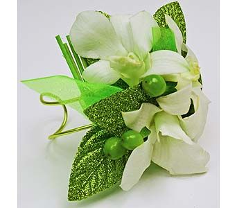 Prom corsage with dendrobium orchids, hypericum berries, rattan sticks organically dyed green, green glitter leaves, sheer green ribbon and a handmade adjustable green wire wristlet
