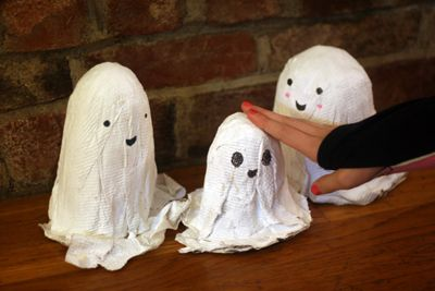 We made these papier-mâché ghosts last week and finally got around to putting on the faces. I...