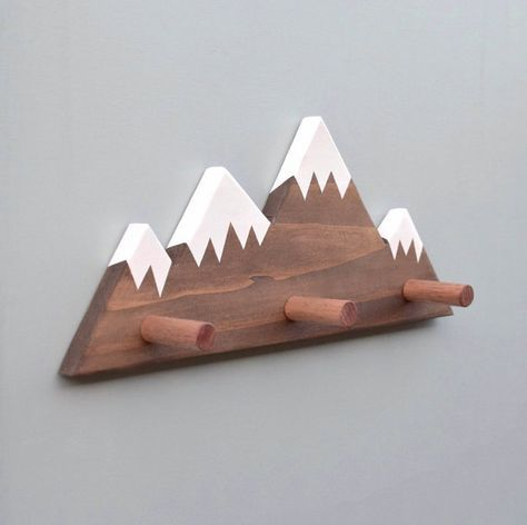 One-of-a-kind Mountain Peak Wall Hook  Have you been searching for both an original and stylish way to hang up yours or your little ones belongings? This one of a kind, Limited Edition Mountain Peak Wall Hook is ready to organise your room with style. Materials: - This Wall hook is carefully created from high-quality, Forest Stewardship Certified Pine. - This wood is sourced sustainably, meaning it is both eco-friendly and ethically produced. This design is coloured using a dark wood stain…