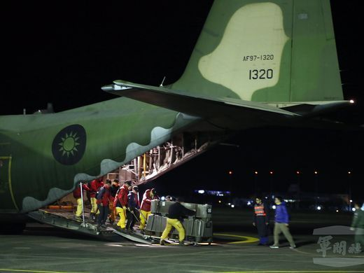 TAIWAN - Earthquake strikes Taiwan - February 7, 2018.  A handout photo made available by Taiwan Military News Agency on Feb. 7, 2018, shows military personnel loading a Taiwan military C-130 transport plane before taking off from the Taipei Songshan Airport to rush rescue personnel and relief goods to Hualien, Taiwan, which was hit by an earthquake.  TAIWAN MILITARY NEWS AGENCY HANDOUT, via EPA-EFE