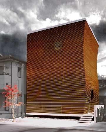 Dom jak geometryczna rzeźba wyróżnia się w okolicy. Drewno na elewacji daje poczucie lekkości i ciepła. Budynek, mimo że przewyższa otaczającą zabudowę, wydaje się ?lżejszy?. Podcięcie elewacji przy samej ziemi potęguje to wrażenie.