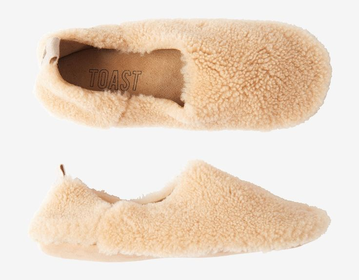 Shearling outer suede inner. Cushioned sole. Cotton herringbone puller on the heel.