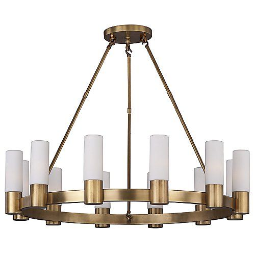Much like traditional candle holders with a modern upgrade, the Maxim Lighting Contessa Chandelier casts a wide spectrum of rich light for your indoor needs. Rectangular tubing is used to frame the satin white cylindrical shades. The contemporary styling of the shades provides soft diffused lighting and transforms a classic style into a modern crown of light.