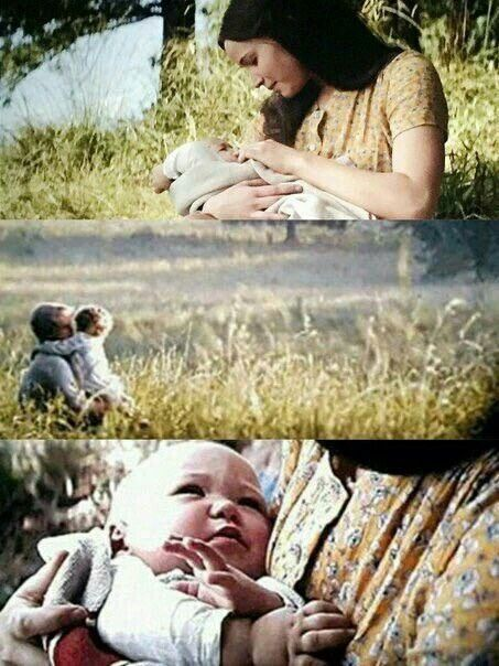 Mockingjay Part 2 Epilogue. So cute! The dress doesn't really suit her, but she deserves this happy ending!