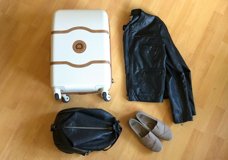 Delsey Suitcase | Jacket | Toms Shoes | Carry On | Whether you're a size 2 or a size 20, it's possible to travel carryon only. Don't believe me? Watch this video to see how! | TravelFashionGirl.com