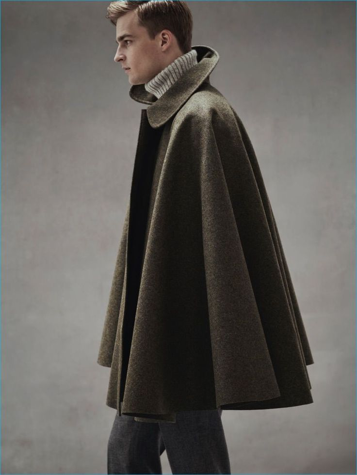 Explore New Silhouettes: Thorben Gartner wears cape coat Cini, turtleneck…