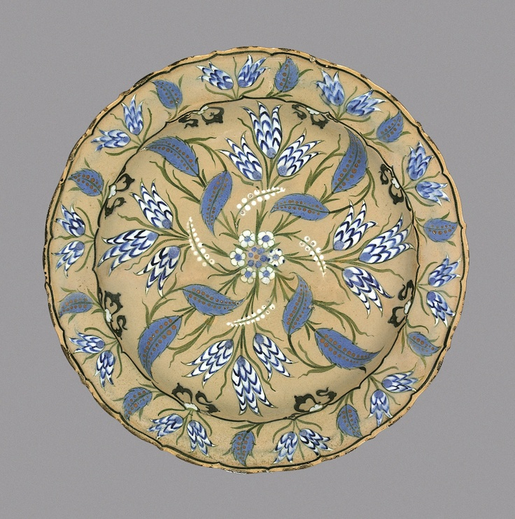 Fritware dish with underglaze painted floral designs on pink ground Iznik, Western Turkey, mid 10th century AH/mid 16th century CE 31.8 cm diameter; 6.2 cm high