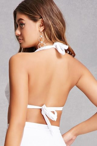 A bikini top by Unique Vintage™ featuring a front knotted bow, a self-tie halter neck, and structured cups with pleated seam detailing. Matching bikini bottoms available.<p>- This item runs large, please size down.</p>