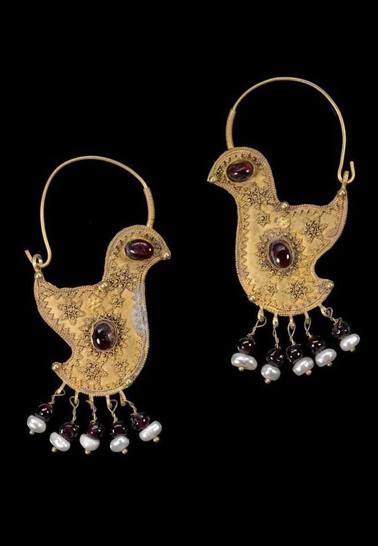 Greater Syria or Persia | Pair of gold hoop 'bird' earrings; gold, with garnet and pearls | 10th century
