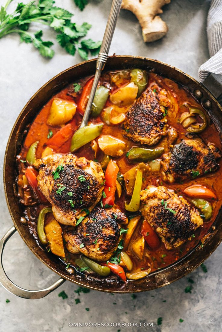 African chicken - Juicy chicken with crispy skin, tender potato, and colorful peppers are brought together by a peanut butter and coconut based sauce.